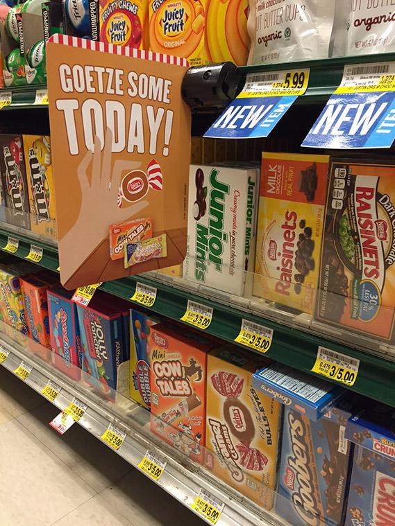 Goetze's Candy shelf talker in the candy aisle